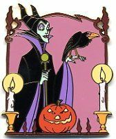 Disney Auctions (P.I.N.S.) - Maleficent Halloween Frame Pin  Maleficent and Diablo display their Jack-o'-lantern (carved pumpkin) in celebration of Halloween on this gold-finished character pin. Disney Auctions exclusive in a limited edition of 1,000 fixed-price pins. There is a lit or burning candle on either side of the pin. Diablo is perched on the back of Maleficent's hand.  SIZE: approx. 1.625 inches x 2 inches  Materials: hard enamel