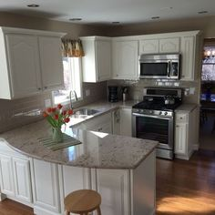 This kitchen was in desperate need of a remodel:  honey oak cabinets, natural bamboo floors that had yellowed with age, almond appliances.  The cabinets were in great condition; we sanded, primed and