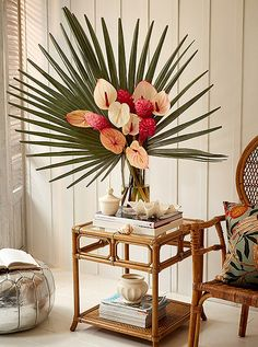 For the floral arrangement two fan palms were used to form a crown around a bundle of pink and white anthuriums. Even without a rattan table to set it on its an accent sure to underscore your tropical point. Tropical Flower Arrangements, Wedding Arrangements, Tropical Flowers, Cactus Flower, Exotic Flowers, Summer Flowers, Beautiful Flowers, Tropical Home Decor, Tropical Houses