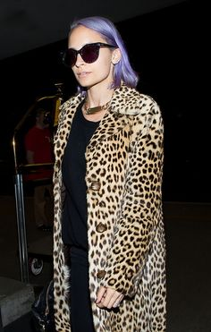 Nicole Richie donning a leopard coat and oversized sunglasses. // #Celebrity