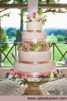 Beautiful Spring Wedding cake      wow i love the gold but prefer silver