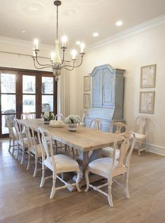 Dining room with wooden rectangle table and cushioned matching chairs | Meredith McBrearty