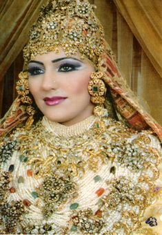 "example of gold jewellery for Moroccan marriage ceremony. If not handed down in a family, the jewellery is usually rented from a marriage organiser called an ""negaffa"". Ngaggaf are usually 7 women who ululate, bring solid gold and gem stone wedding jewellery, the ameriyas and palanquins, the porters, and sometimes clothing. Prices begin at $350 a night depending on what they bring."