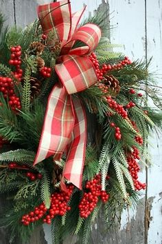 .Love this wreath of various greens, red berries, and red plaid ribbon!!! Bebe'!!! Great wreath for the holidays!!!