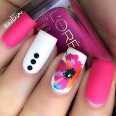 Pink and white is a refreshing color for nail polish especially in matte. But add this wonderful flower design and it just makes everything much better.