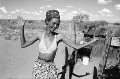 South Africa. Kalahari Desert. Woman dances at her homestead