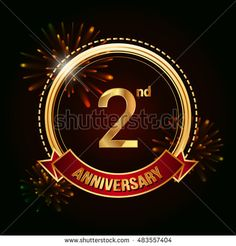 2nd anniversary logo golden colored using ring, red ribbon, and fireworks…