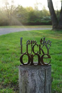 A personal favorite from my Etsy shop https://www.etsy.com/listing/229465644/i-am-the-lucky-one-metal-word-stand