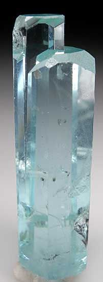 Aquamarine   Shigar Valley, Skardu District, Pakistan Aquamarine- (Beyrl)-  composed of beryllium aluminium cyclosilicate with the chemical formula Be3Al2(SiO3)6. ....The pale blue color of aquamarine is attributed to Fe2+ , hardness of 7.5–8,  Crystal system	Hexagonal