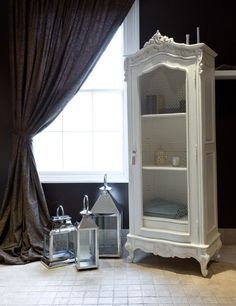 This wire-fronted Book Cabinet will feel at home just about anywhere in the house, providing an elegant display space for beautiful things. It comes complete with three shelves and one drawer. All of our exquisite, rococo-styled armoires are hand-carved from sustainable sourced mahogany and are painted in antique white with a subtly distressed finish.  Please note that this armoire weighs approximately 100kg and comes fully assembled.