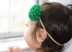 Whether its your babys first St Patricks day or her 7th, this simple green pom pom flower headband is a fantastic addition to any St Patricks day outfit. Add that little touch of Irish green needed to make her outfit the luckiest of the day.  Made with green felt, this pom pom flower is 2 inches in diameter and is attached to your choice of a Nude, Black, or White nylon headband. The nylon is soft on your babys head and stretches and grows as your baby grows too! What else is fabulous about…