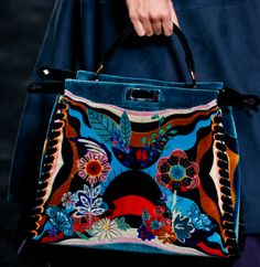 As someone who both loves Fendi bags and dislikes ruffles, Karl Lagerfeld and Silvia Venturini Fendi have me in a bit of a bind for Fall 2016. Ruffles and waves were the entire basis of the collection, from the furs down to the sold-separately bag straps, almost as if a scientist had tipped Karl off …