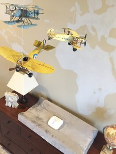 Check out this adorable airplane themed nursery with a world map painted on the…
