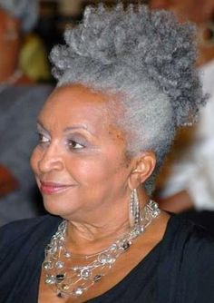 Beautiful, natural grey hair... hope as I continue to grey it's as gracefully as this woman!