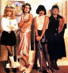 Queen on set of their I Want To Break Free music video. The video was shot on 22 March and 4 May 1984 at Limehouse Studios it and cost… Queen Freddie Mercury, Brian May, John Deacon, I Am A Queen, Save The Queen, Jimi Hendrix, Green Day, Queen Banda, Free Music Video