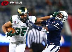 Canon 1Dx, 400mm, 5000iso, f2.8, 1/1600th, Manual Colorado State Rams running back Izzy Matthews (35) stiff arms Nevada Wolf Pack defensive back Asauni Rufus (2) in the second half of the Arizona Bowl at Arizona Stadium. Nevada defeated Colorado State 28-23. Mandatory Credit: Mark J. Rebilas-USA TODAY Sports
