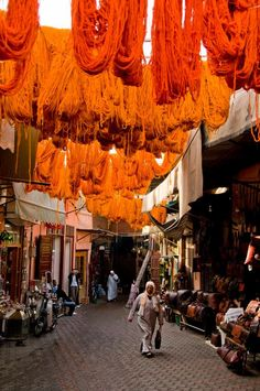 """Yarn Alley"" boasts a sky of vibrant colour, thanks to cloth vendors in this Marrakech, Morocco souk."