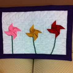 3D pinwheel flower quilted wallhanging ---it will be my May office quilt (the kind of flowers I can't kill)
