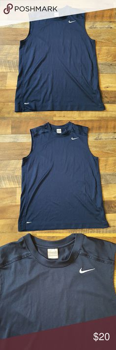 """Nike breathable Men's workout Tee  Size L Men's Nike dark blue workout top great condition slight mark hardly noticeable as shown on last picture. Size: Large  As all workout clothes has some stretch.  Measurements: Length: 29"""" Arm to arm pit: 22"""" across  100% polyester Nike Shirts Tank Tops"""