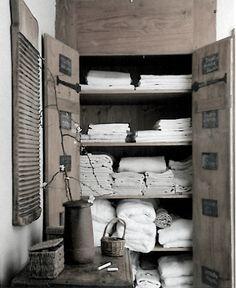 = wood linen cupboard with chalkboard labels
