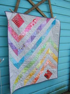 prism, I have a rainbow jelly roll that could be made into something like this.  Very pretty.
