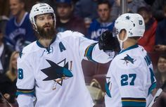 San Jose Sharks defenseman Brent Burns celebrates his first period goal with forward Joonas Donskoi (Sept. 22, 2015).