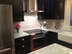 White beveled subway tile- kitchen