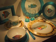 Limoges porcelain, collection dinner ware, cups and saucers, coffee sets, plates,trays for boats or seaside house! mix and match of different tropical fishes, borders hand painted blue sea or yellow portholes version.