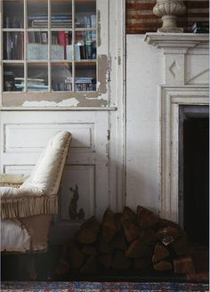rustic white paint, living room, vintage book case with glass and fireplace