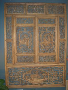 Wood panel with center opening windows.  3 feet x 5 feet.  Exquisite detail.  Must be seen to be appreciated.