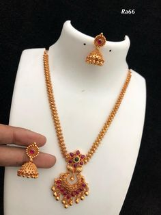 Temple jewellery available at Ankh Jewels for booking msg on Gold Jhumka Earrings, Jewelry Design Earrings, Necklace Designs, Gold Mangalsutra, Pendant Jewelry, Pearl Jewelry, Gold Pendant, Gold Choker, Bead Jewellery