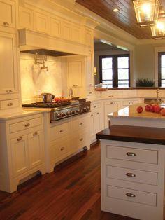 Perfect cabinets - Burkitt Raised Luxury Home Kitchen Photo 01 from houseplansandmore.com