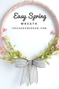 How to make an easy Spring Wreath  using an embroidery hoop, flowers, and chunky knit yarn! #embroideryhoop #spring #wreath #crafts #DIY #yarn #flowers