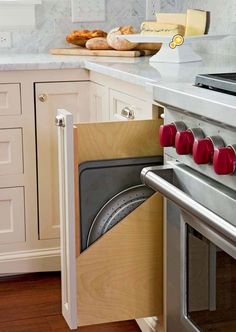 This is close. Light countertop with large features. Shaker-style cabinets, dark floor. Even a nifty baking sheet pull-out.