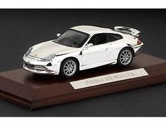 This Porsche 911 GT3 (2001) Diecast Model Car is Chrome Effect and features working wheels. It is made by Ex Mag and is 1:43 scale (approx. 9cm / 3.5in long). This model comes on a real wood base with name plaque....