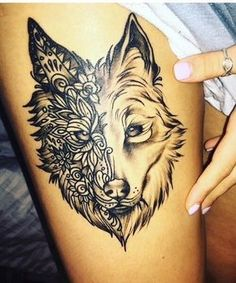 Husky tattoo on right thigh nxt to golden retriever ribbon under says babies