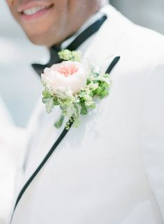 Garden rose boutonniere: http://www.stylemepretty.com/ohio-weddings/cleveland/2015/05/19/fabulous-multicultural-wedding-in-cleveland/ | Photography: Arielle Doneson - http://www.ariellephoto.com/