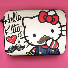 428a95082 Loungefly Hello Kitty Mustache Laptop Case (Tan with Colored Details)