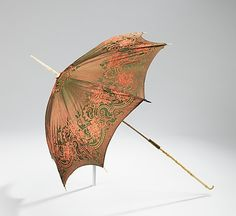 Silk parasol, European, 1850-59. This style of parasol is the ultimate in frivolity and fancifulness. The particularly special element is the lovely carved hand on the spike. Carriage parasols were ostensibly used to shade the wearer from the sun and they were initiated by Queen Victoria in the 1840s when riding in open carriages began. This parasol purportedly belonged to a member of the royal family of Austria during Franz-Joseph's reign (1830-1916), emperor of Austria from 1848-1916.