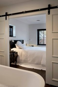 White Bedroom with sliding doors// Barn doors for the kitchen. Style At Home, Decoration Inspiration, White Bedroom, White Bedding, Modern Bedroom, Interior Barn Doors, Beautiful Bedrooms, Interiores Design, My Dream Home
