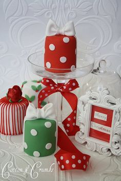 "Individual red and green polka dotted and striped ""Merry Christmas"" mini cakes."