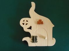Fairy Door Kit includes, door and frame, 1 hinge and screws, door handle, and a choice of 6 decorations. You can choose between 6 different decorations : dragon, cat, thistle, shamrock, treble clef or dragonfly. It was created by scroll saw artist Joanne MacKenzie
