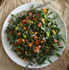 Kale Superfood Salad Recipe Salads with kale, carrots, purple onion, berries, pumpkin seeds, edamame, tomatoes