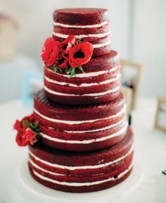 simple deep red naked wedding cake with clusters of red anemones   Found for you by www.astrabridal.co.nz  