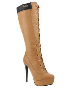 The humble work boot gets a glamorous makeover in theMichigan Knee High Boot by PLUM. These tan boots feature a contrasting, padded topline and lace-up front for a look that daring and instantly recognisable. Pair these boots with skinny jeans and a faux fur coat.