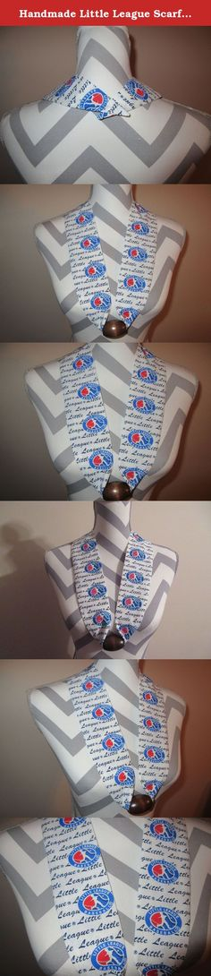 Handmade Little League Scarf by Ladies Fashion Collars Unique No Tie Baseball Little League Print Scarf with Wood Brown Bead One Size Fits All Cotton Print Gift for Her with Gift Bag and Ribbon. Handmade Ladies Fashion Collars Fabric Scarf Necklace Baseball Little League Cotton Print with a Wood Brown Bead -- Blue Red and White with Black Little League Lettering. One Size Fits All; Simply Slip it Over Your Head; Lightweight Only 1 Ounce, Bead holds decorative fabric scarf in place...