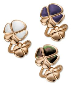 Collection Viola Crossover Rings      Flower blossom inlaid with stone crosses a gold blossom, in 18-karat gold. Cellini's Viola Collection features coordinating necklace, bracelet and ring.