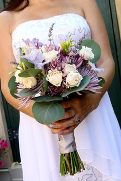 shades of purple and ivory in this wedding bouquet by Reynolds Treasures