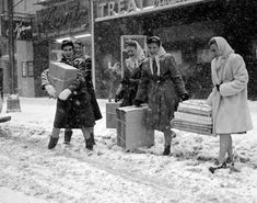 This quartet of holiday shoppers braved the falling flakes at William and Broad Sts. in Newark, circa 1945.