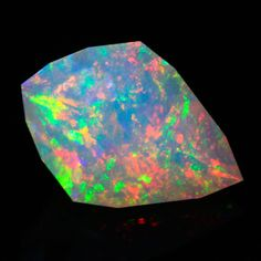 Faceted Ethiopian opal is our best selling material because of the way the colors are enhanced by the faceting. Red flash can be seen to roll off the pavilion facets and the crystaline type material that is best for faceting does not mask the vivid colors seen in Welo opal. Colors in this opal are amazing and include the entire rainbow.
